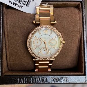 NWT Michael Kors Gold Watch. Comes adjustable.